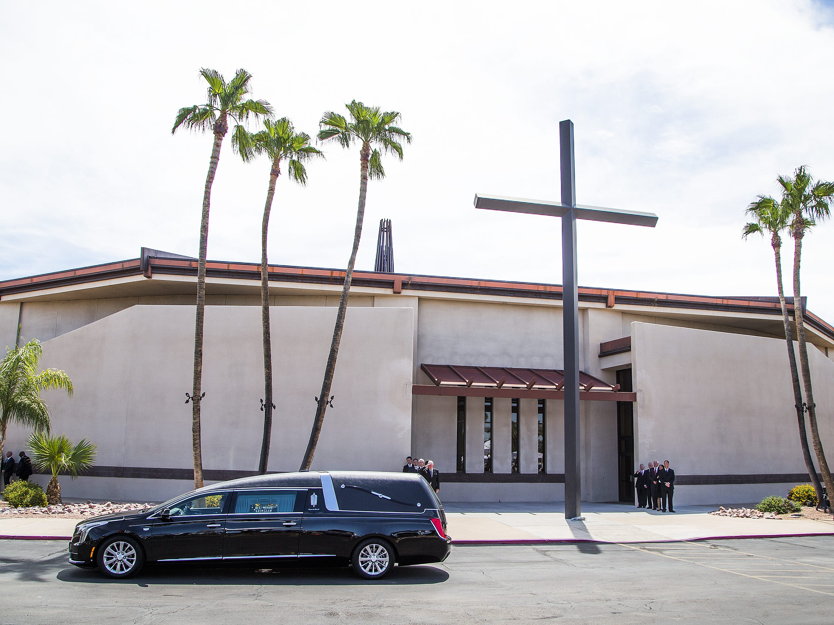 A hearse with the casket of Sen. John McCain leaves North Phoenix Baptist Church in Phoenix, Aug. 30, 2018, after a memorial service was held. McCain's body will now be flown to Washington, D.C.