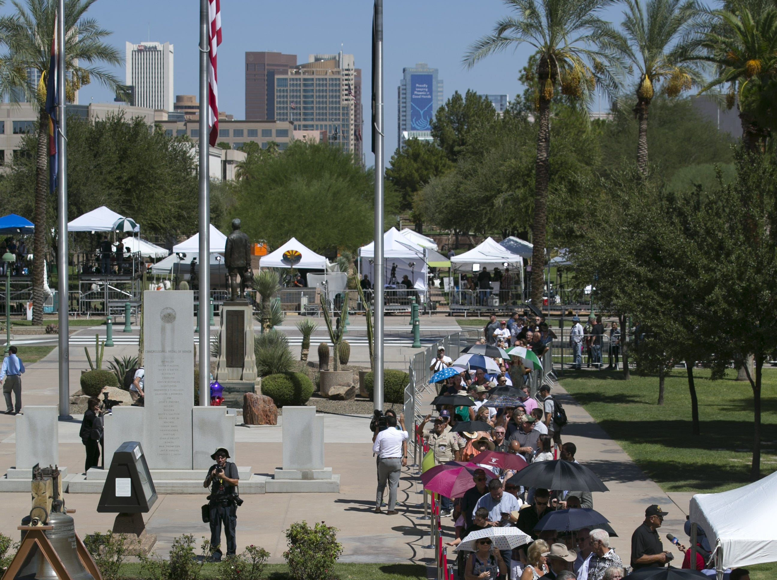 People wait in line to enter the Arizona Capitol building during a public viewing as Senator John McCain lies in state in Phoenix on Wednesday, August 29, 2018.