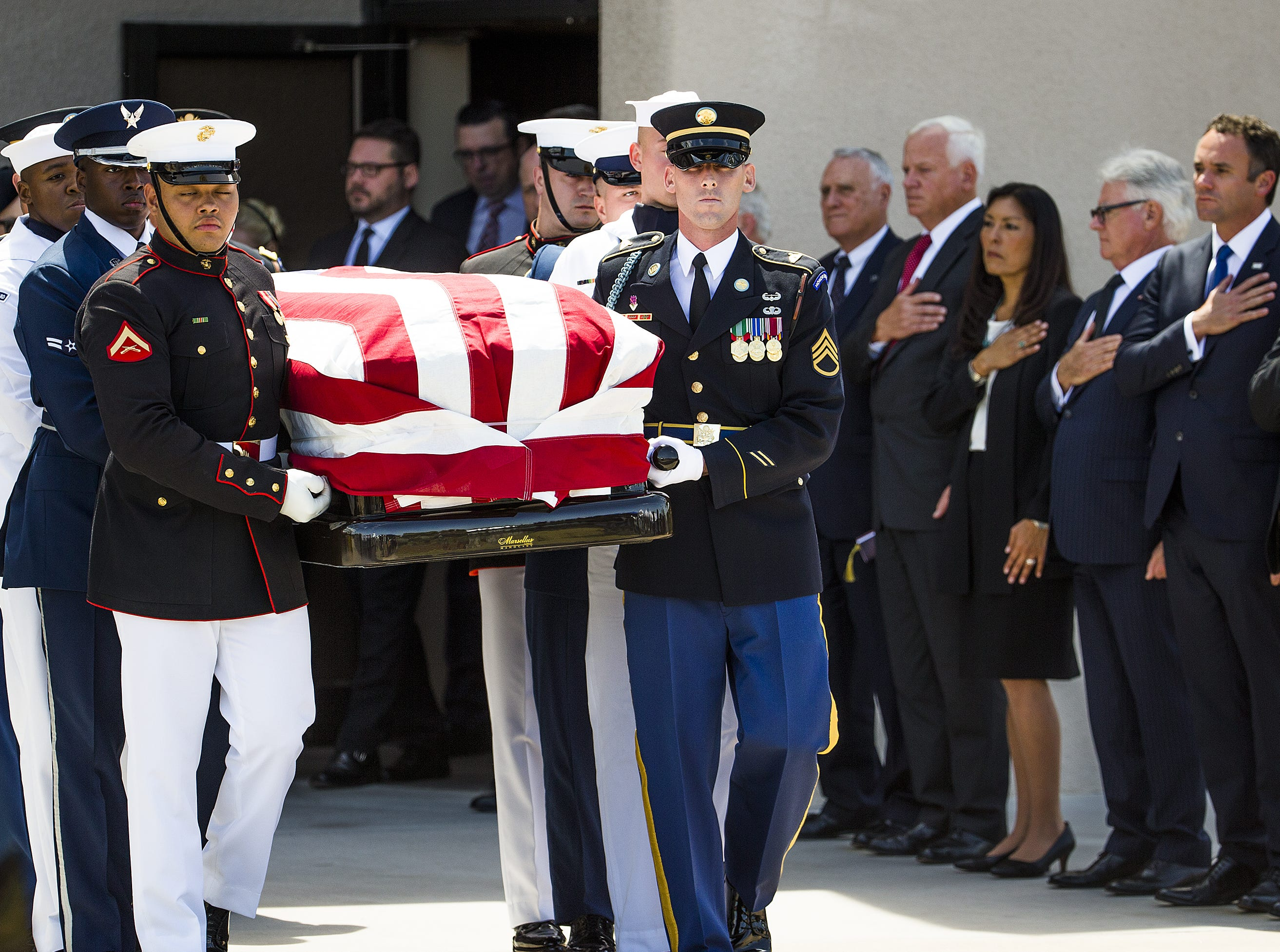 A military honor guard carries the casket of Sen. John McCain from  North Phoenix Baptist Church in Phoenix, Aug. 30, 2018. A memorial service was held  and now McCain's body will be flown to Washington, D.C.