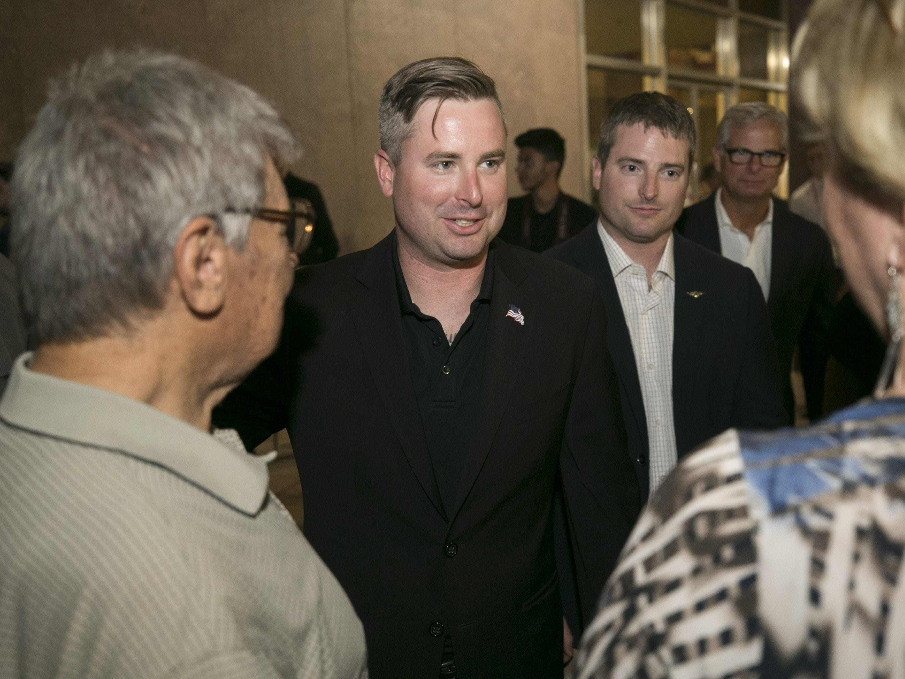 Jimmy McCain, (center left) and Jack McCain, (center right) the sons of Sen. John McCain, greet people who came pay their respects to their father as they wait in line to enter the Arizona state capitol where Senator John McCain lies in state in Phoenix on Wednesday, August 29, 2018.