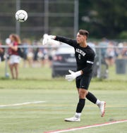 Arlington's goalie Kevin Klausz throws the ball back into play during Thursday's game versus Monroe Woodbury on August 30, 2018.
