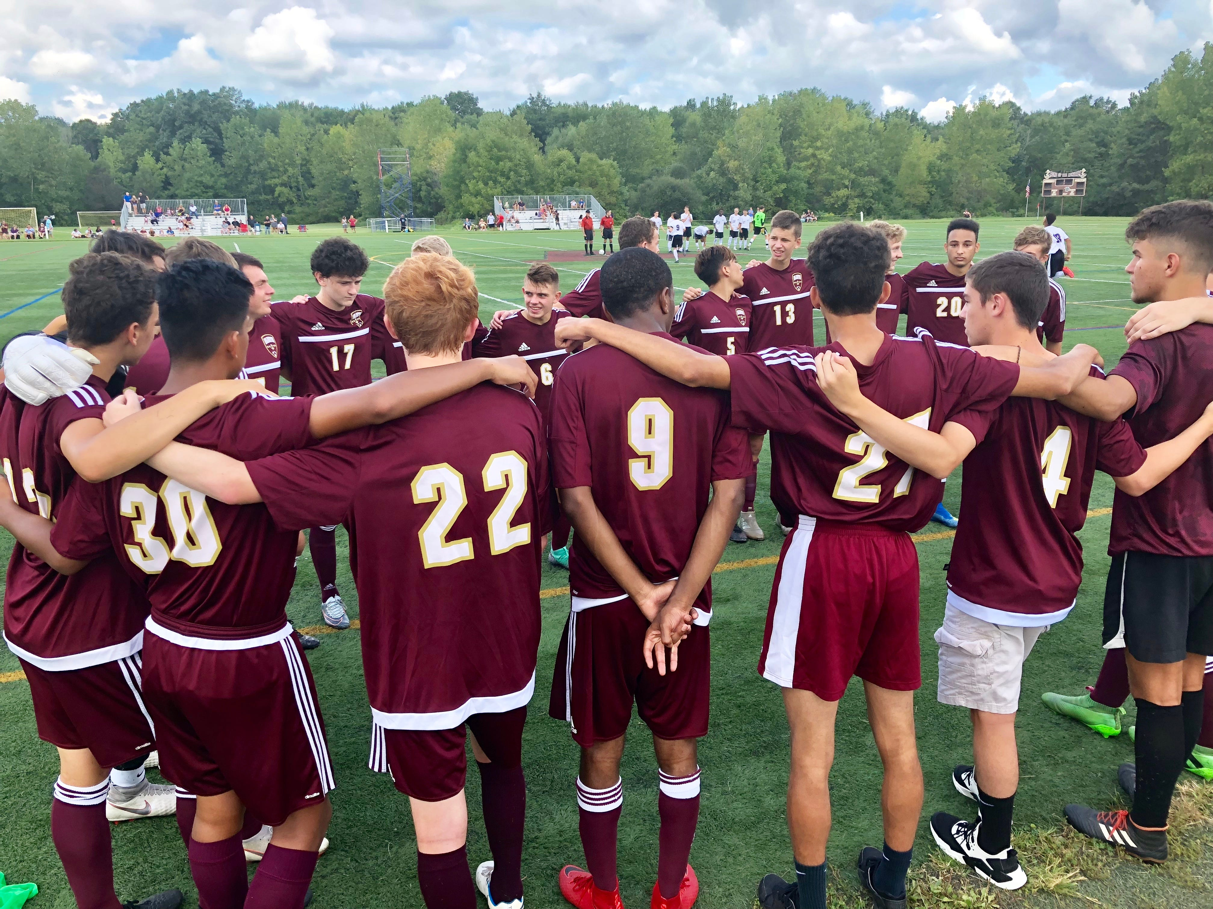 The Arlington High School boys soccer team huddles before its match on Thursday against Monroe-Woodbury.