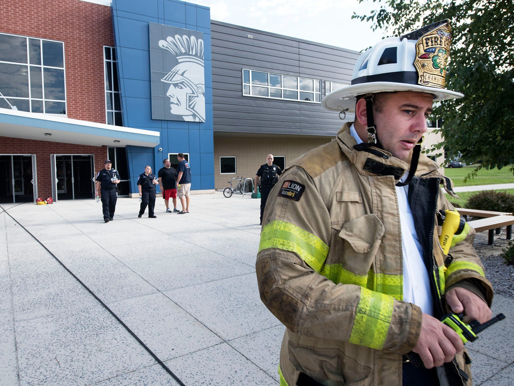 Chambersburg Fire Chief Dustin Ulrich takes command in front of CASHS. Chambersburg Area Senior High School students were evacuated Thursday morning, August 30, 2018 after a battery ignited a fire in a storage room , sending smoke throughout the building.