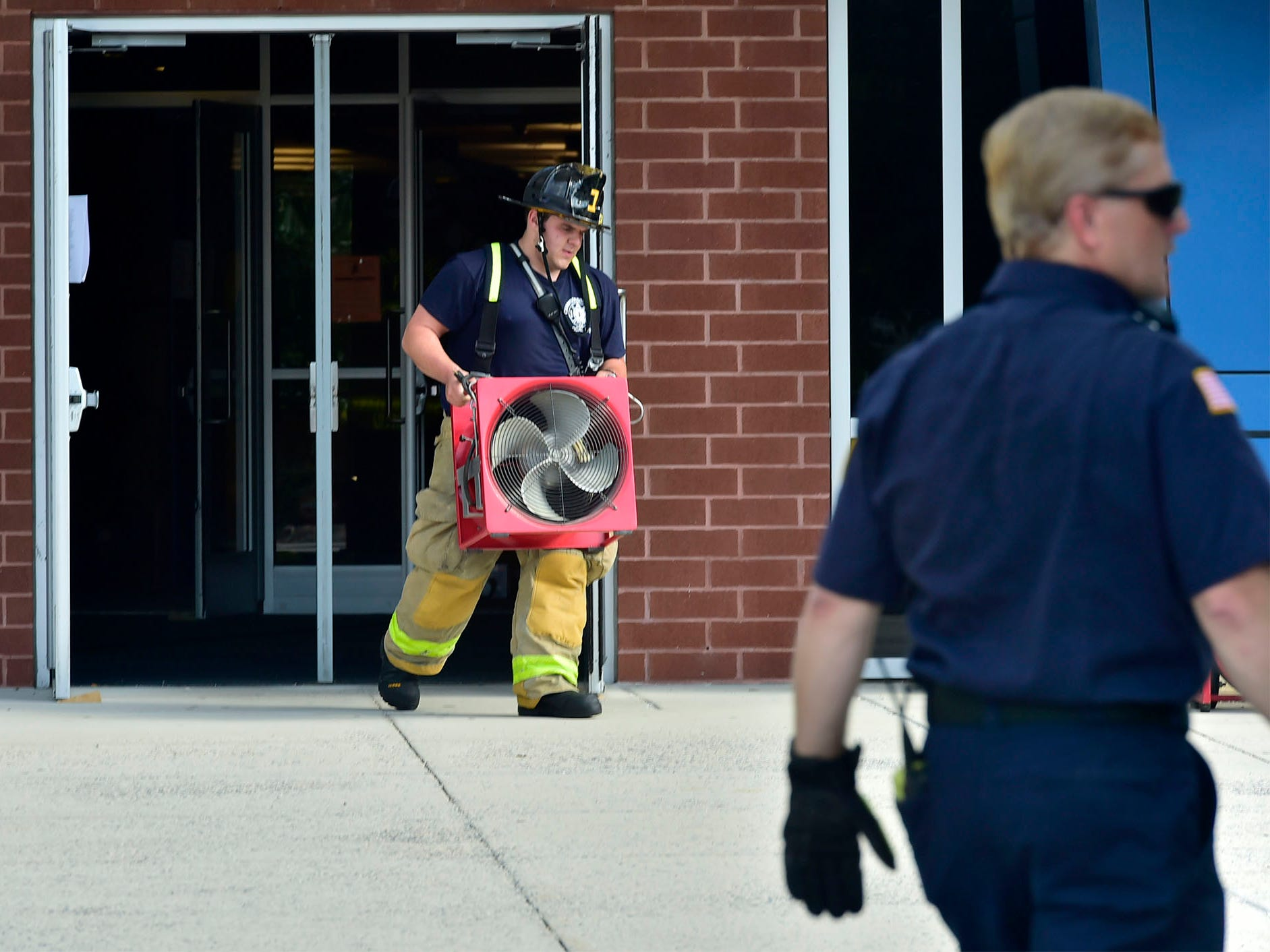Chambersburg Area Senior High School students were evacuated Thursday morning, August 30, 2018 after a battery ignited a fire in a storage room , sending smoke throughout the building.