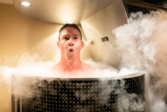 YDR reporter John Buffone reacts to the frigid temperature inside the cryotherapy chamber at the York Medical Spa.