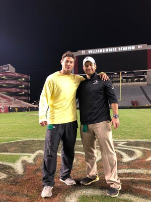 Mike Gasparato, left, and younger brother Greg stand midfield at University of South Carolina's Williams Brice Stadium in 2017.