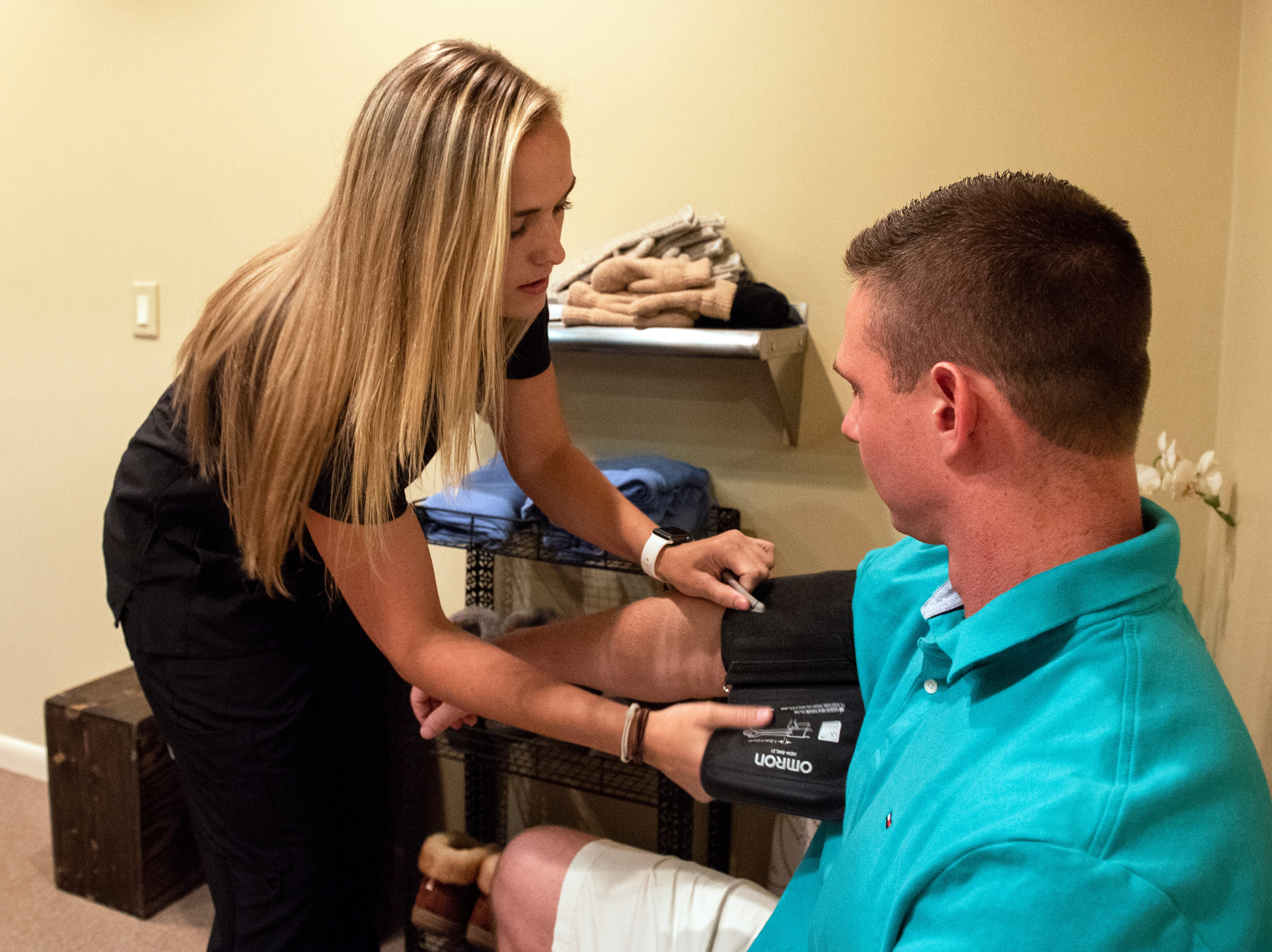 Cryotherapy technician Alison Shreiner, left, takes the blood pressure of YDR reporter John Buffone prior to getting in the cryotherapy chamber, Tuesday, Aug. 27, 2018. Cryotherapy is a treatment using liquid nitrogen gas in an enclosed chamber to surround a patientÕs body with freezing temperatures.
