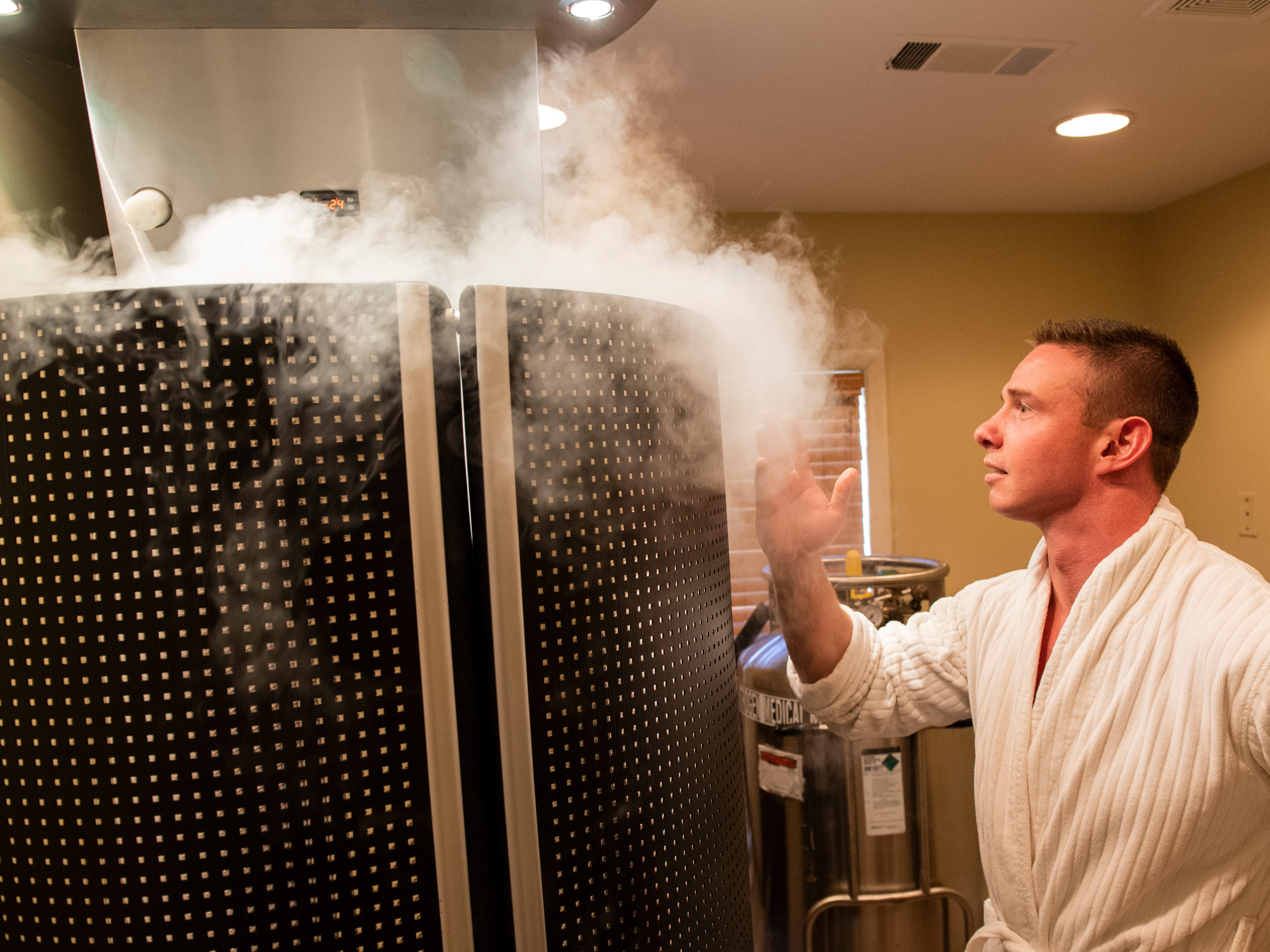 While nitrogen gas is released in the chamber, the chill of the gas fills the room, Tuesday, Aug. 27, 2018. Cryotherapy is a treatment using liquid nitrogen gas in an enclosed chamber to surround a patientÕs body with freezing temperatures.