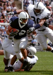 Mike Gasparato (22) breaks through the defense during the 2004 Blue-White Game in Beaver Stadium. Injuries ended his playing career prematurely, though his final carry was a 22-yard touchdown against Central Florida. Fourteen years later he's battling late-stage cancer in South Carolina.