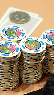Atlantis poker chips are stacked in front of a player in 2011.