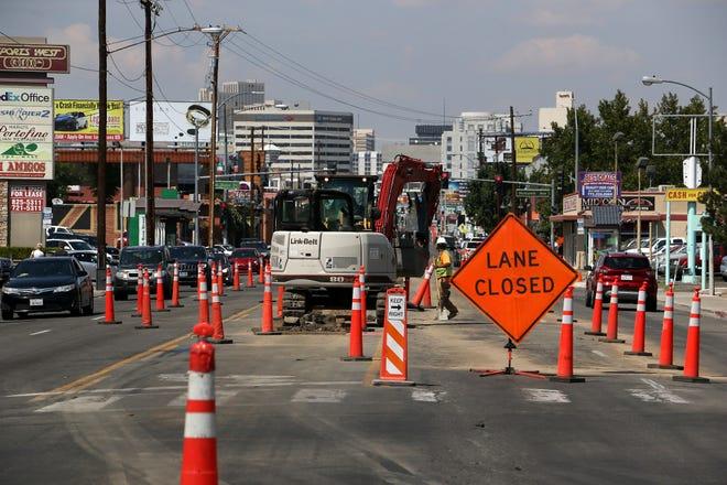 Road crews begin work on Virginia Street in midtown Reno on Aug. 29, 2018.