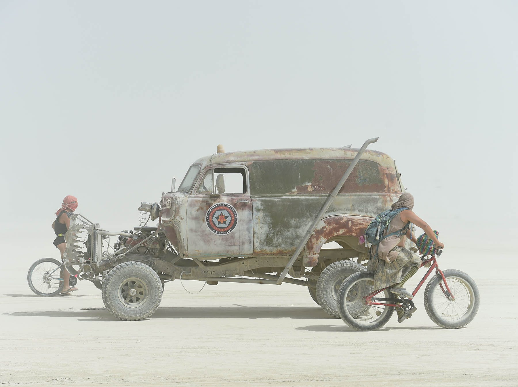Burners have a dusty Thursday morning on the playa.