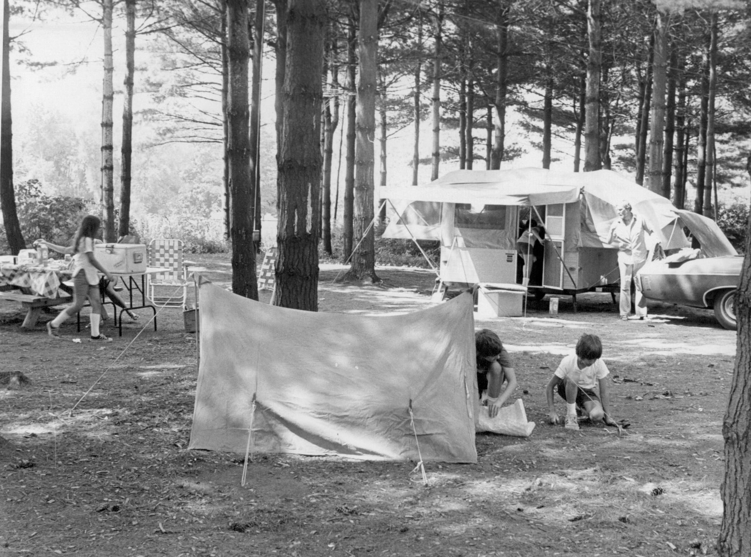 In this photo from 1975, people set up at a camp site at Hamlin Beach State Park.