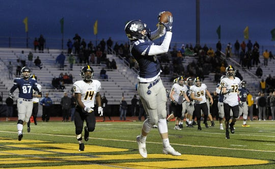 Pittsford's Kevin Ryan catches a touchdown pass to put the Panthers up 28-27 over McQuaid during the 2017 Section V Class AA semifinals. Pittsford scored 35 unanswered points to advance to the Class AA final with 35-27 win over No. 5 McQuaid.