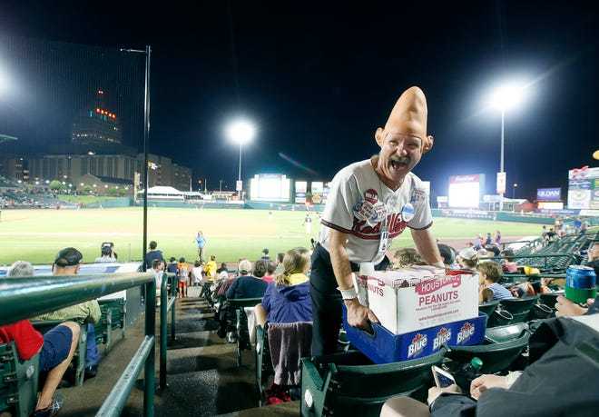 """Tom Girot, aka Conehead, has some laughs with customers after stating """"You can't be a vendor if you're gonna embarrass easily"""", while making his rounds at a Red Wings game at Frontier Field."""