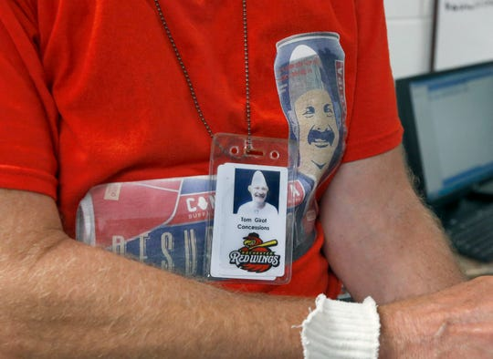 Tom Girot, aka Conehead, prepares for his rounds at a Red Wings game at Frontier Field.