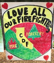 A colorful sign posted along Lake Boulevard thanks firefighters for their work.