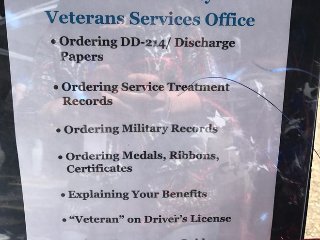 A sign detailing the records and other items the Shasta County Veterans Services Office is replacing for victims of the Carr Fire hangs at Shasta College August 29, 2018.