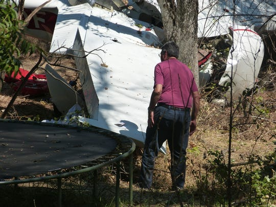 A Federal Aviation Administration inspects Thursday the Cessna 150 that crashed Wednesday near Benton Airpark in Redding.
