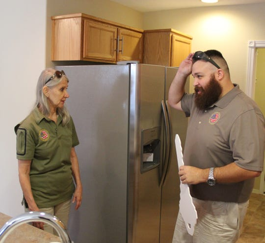 Charlie Patrick (right) discusses the newly remodeled kitchen with Military Warriors Support Foundation Senior Vice President Andrea Dellinger.