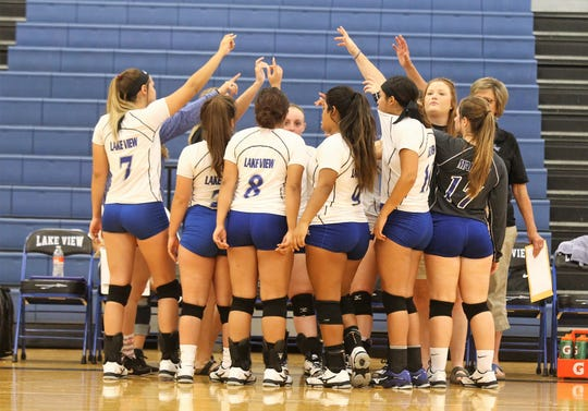 Lake View High School volleyball breaks the huddle.