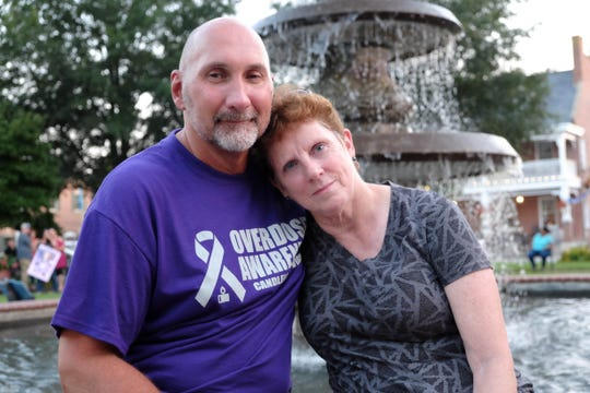 Liz Isaacs, who lost her son, Dylan Isaacs to a drug overdose last year, sits with her friend, Jim Kakas, who will be in recovery for nine years come November.