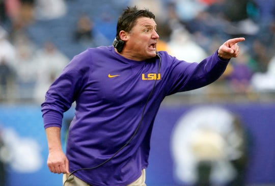 LSU Tigers head coach Ed Orgeron calls to a player during the second half against the Notre Dame Fighting Irish in the 2018 Citrus Bowl at Camping World Stadium.