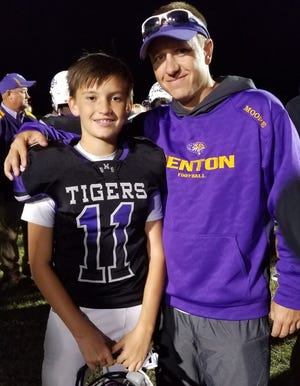 Benton coach Reynolds Moore shares a moment with his freshman son, RJ.