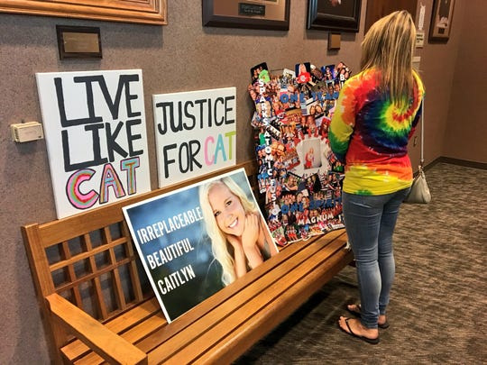 A supporter of Caitlyn Carman waits outside of a Minnehaha County courtroom Thursday, Aug. 30, for the court trial of Mark Begeman, who was cited with careless driving in the March crash that killed 19-year-old Carman.