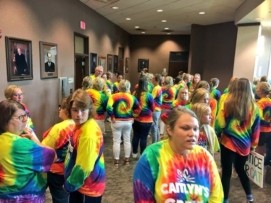 A group of supporters for Caitlyn Carman wait for the court trial of Mark Begeman, who was cited for careless driving in a March 2018 crash that killed 19-year-old Carman, outside of a Minnehaha County courtroom Thursday, Aug. 30.