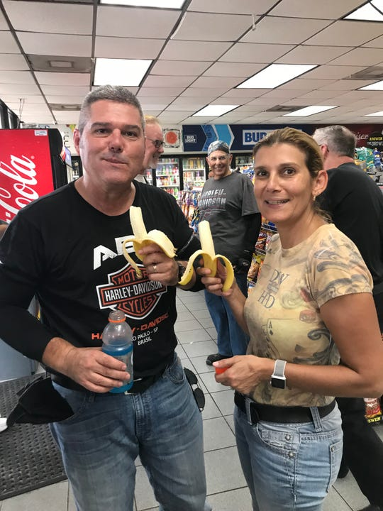 Marco and Carla Veiga of Ft. Lauderdale, Fla. drink Gatorade and eat bananas to stay hydrated and energized during the first day of the southeast leg of Harley-Davidson's Rides Home.