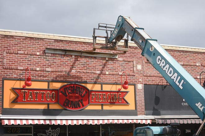 Public works moves a telelift against the Vishnu Bunny Tattoo & Piercing building Thursday, Aug 30, in downtown Sioux Falls. A facade is leaning and will likely need to be replaced.