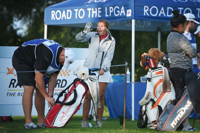 Kate Wynja waves to family and friends before she tees off at the first hole during the GreatLife Challenge Women's Symetra Golf Tournament Thursday, Aug 30, at Willow Run Golf Course in Sioux Falls.