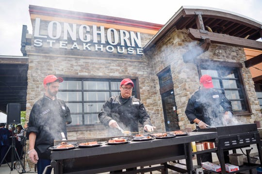 "LongHorn Steakhouse will have ""Grill Masters"" like these guys available Monday, Sept. 3 to answer grill questions on its GRILL US Hotline and over social media."