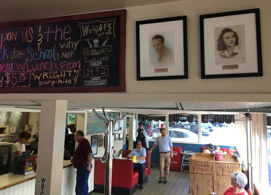 Inside Wright's Dairy-Rite are photographs of Forester and Alka Wright, Dustin Wright's great-grandparents. They opened the iconic Staunton restaurant in 1952. When Dustin was 12, his first job was running deliveries for his grandparents who owned the Stock Exchange Deli, now home to Aioli restaurant in Staunton.  Also in the picture is Forester Wright's grandson James Cash. The Cash family now own the family restaurant.