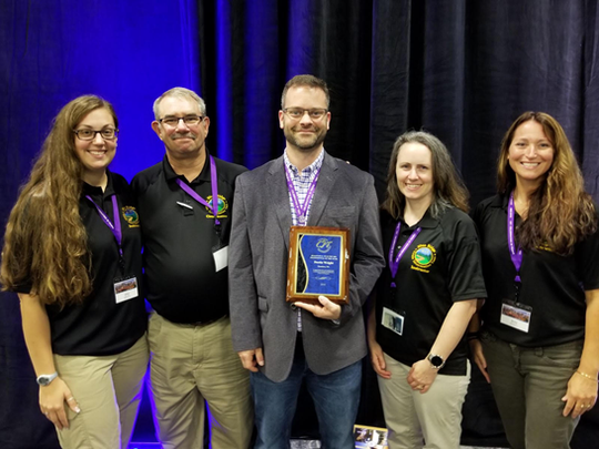 Waynesboro Police Dept. CIT instructor Alison Willis, Waynesboro Police Dept. CIT coordinator Capt. Kelly Walker, CIT instructor Dustin Wright of Wright Psychological Services in Staunton, Staunton Police Dept. Communications Officer Christine Bandy and Waynesboro Police Dept. CIT instructor Capt. Rebecca Meeks at the 2018 CIT International Conference in Kansas City, MO, on Thursday, Aug. 16, 2018. Wright is holding his 2018 plaque for CIT International Behavioral Healthcare Professional of the Year.