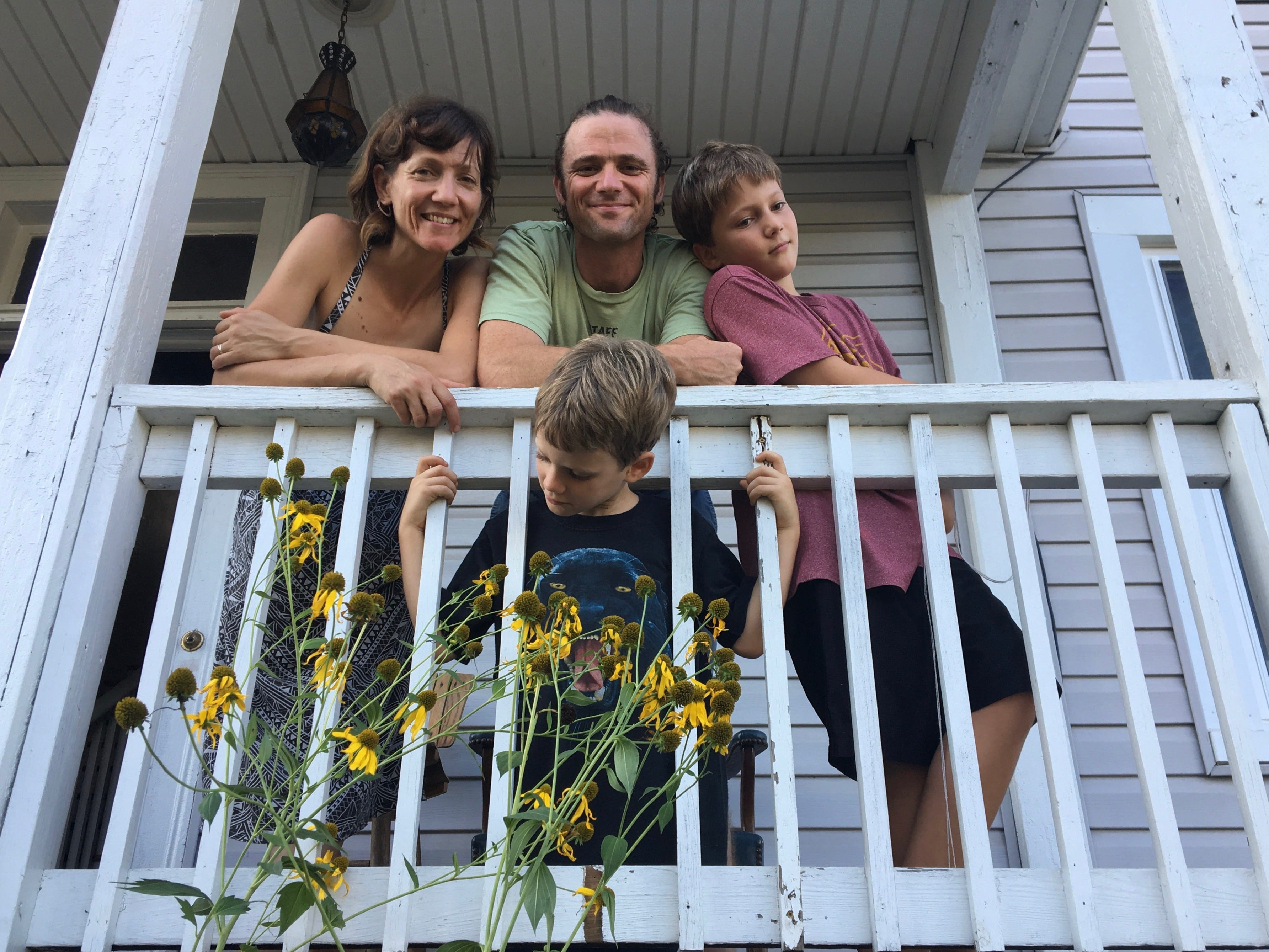 The Bergland family pose for a photograph on their front porch outside their Staunton home on Wednesday, Aug. 29, 2018. Standing is Louella, Alan and Langston. Kneeling down in front is Abel. Their home is filled with monarch butterflies, caterpillars and dozens of chrysalises thanks to planting milkweed in their yard. They also have sunflowers everywhere.