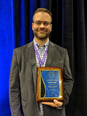 Staunton's Dustin Wright holds his 2018 plaque for CIT International Behavioral Healthcare Professional of the Year at the 2018 CIT International Conference in Kansas City, MO, on Thursday, Aug. 16, 2018.