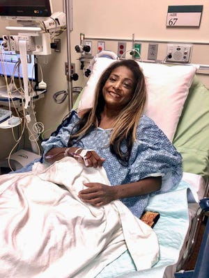 Bel Kambach smiles 25 days after a liver transplant at the Arizona Mayo Clinic for a photo taken by her sister Joan Taveras.