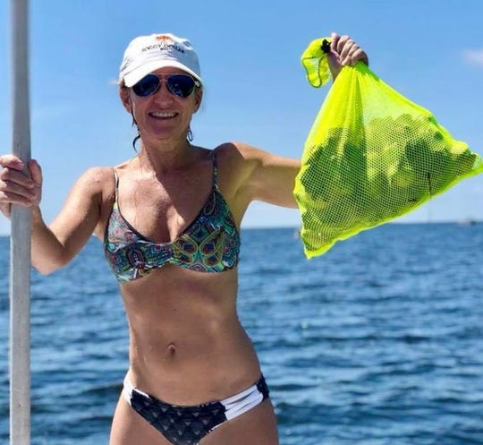Suzy Evans with a bag of scallops she got skimming along the bottom below the freshwater on the surface in Steinhatchee.