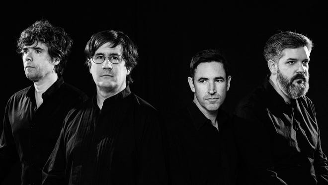 The Mountain Goats, photographed on Dec. 20, 2016, in Durham, N.C.