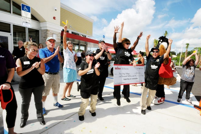 Fort Pierce Police Department Hoagie Making Team celebrates the announcement of their win over the St. Lucie County Fire District.