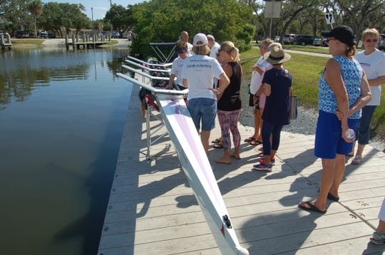 """A sleek new rowing shell named """"Friends"""" recently was christened at the MacWilliam Park Boat Basin in Vero Beach."""