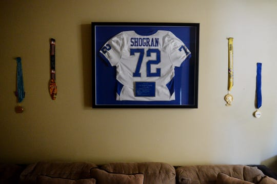 "As a way to honor William Shogran Jr., Sebastian River High School retired his football jersey which now hangs framed in the front room of his parents' home. Shogran died in August of 2014 at a football practice from heat stroke-related symptoms. Courtney and William Shogran are petitioning the FHSAA and state legislators to require ice baths at every practice and game. ""I think that ice baths should be required for every outside sport,"" said Courtney Shogran."