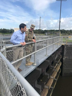 U.S. Sen. Marco Rubio, left, looks over the railing Thursday, Aug. 30, 2018, at the St. Lucie Lock and Dam with Lt. Col. Jennifer Reynolds, deputy commander for the Army Corps of Engineers in Florida.