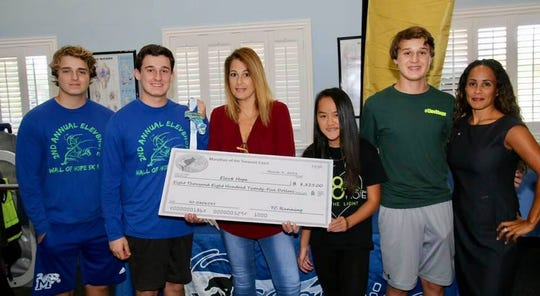Elev8Hope's Trevor Shpiruk, Henry Shpiruk, Rina Esposito- Shpiruk, Devon Shpiruk, Mitchell Shpiruk and Ann Rodriguez of SunTrust with a check for $8,825.