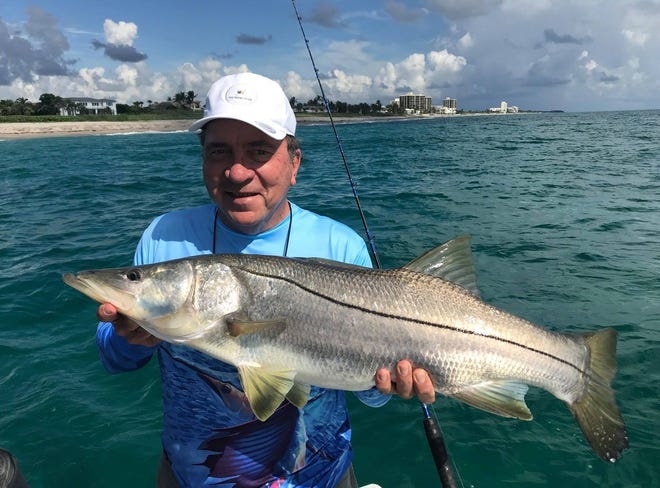 Major League Baseball Hall of Fame catcher Johnny Bench can't wait for the opening of snook season after catching and releasing a 40-inch snook near Jupiter last week while fishing with Bryan Connley of Connley Fishing Tackle and Capt. Matt Budd of Jupiter Fishing Academy.