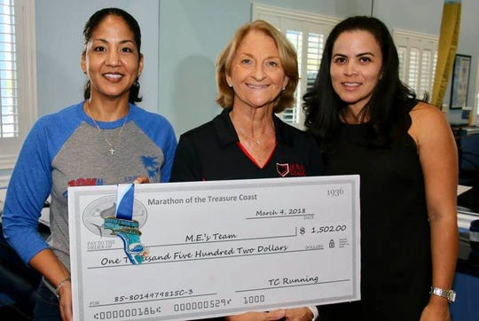 Congratulations to M.E.'s Team Lisa Tom, left, Karen Hester and Hilda Fernandez-Greene on receiving $1,502 from the Marathon of the Treasure Coast proceeds.