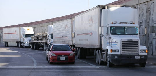 Trucks wait to turn south into Mexico at the Zaragoza Bridge in El Paso's Lower Valley. File art.