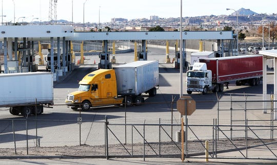 Tractor-trailers file out of the commercial import lot at the Bridge of the Americas after coming over from Mexico.